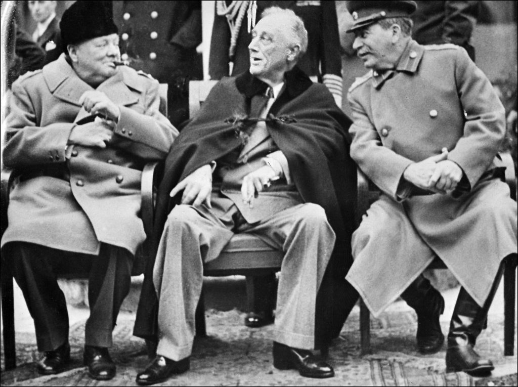 From left, former British Prime Minister Winston Churchill, U.S. President Franklin Delano Roosevelt and Soviet Communist Party Secretary General Joseph Stalin pose at the start of the Conference of the Allied Powers in Yalta, Crimea, on Feb. 4, 1945 at the end of World War II. STF/AFP/Getty Images