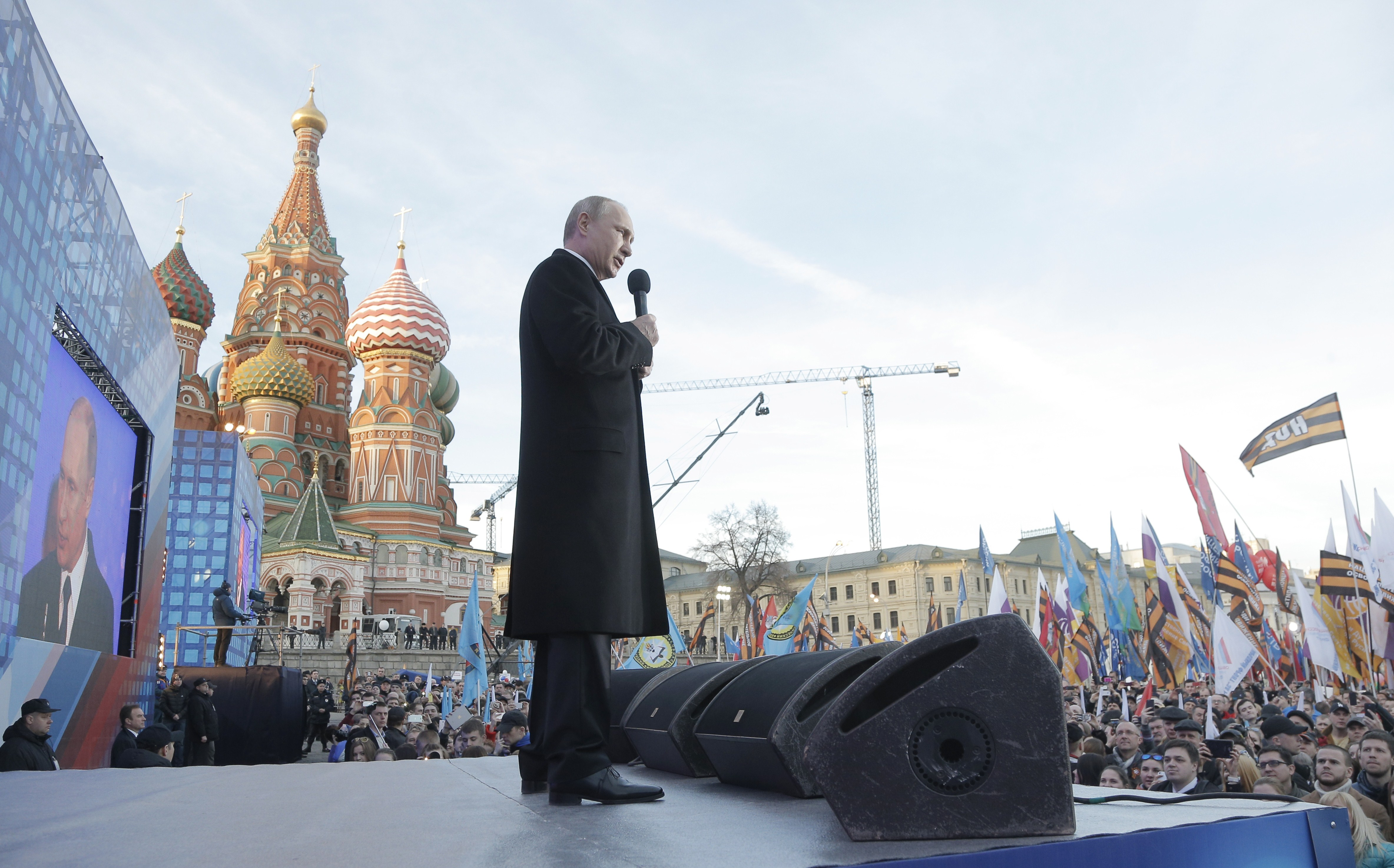 Russian President Vladimir Putin gives a speech during a rally and a concert in central Moscow on March 18, 2015, to mark one year since he signed off on the annexation of Crimea in a epochal shift that ruptured ties with Ukraine and the West. MAXIM SHIPENKOV/AFP/Getty Images