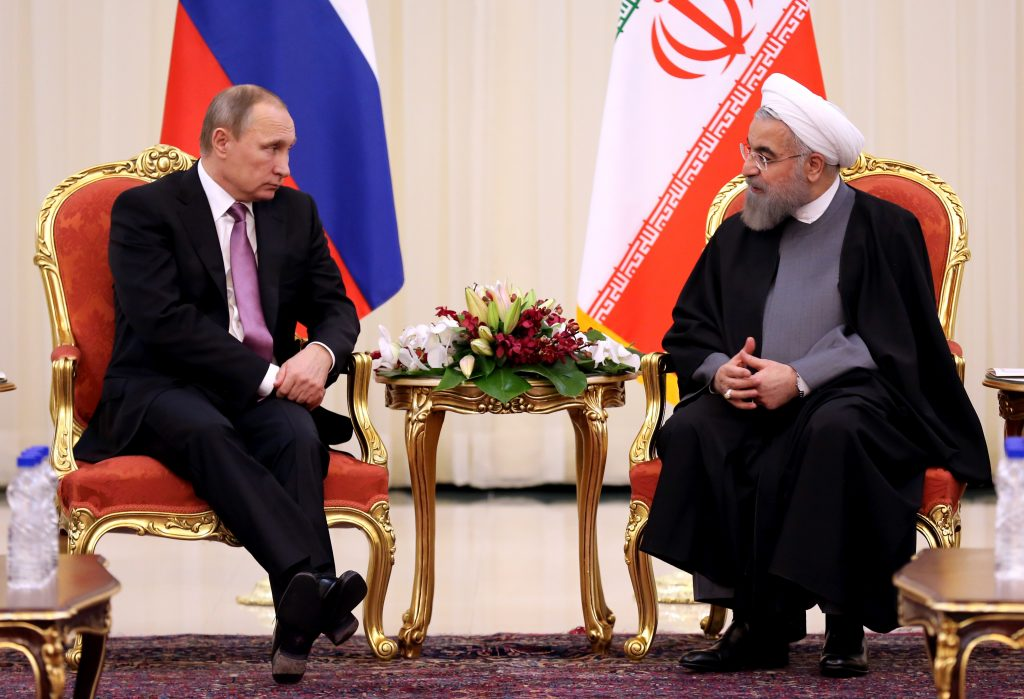Iranian President Hassan Rouhani (R) meets with Russian counterpart Vladimir Putin during the Gas Exporting Countries Forum summit in Tehran, on Nov. 23, 2015. ATTA KENARE/AFP/Getty Images