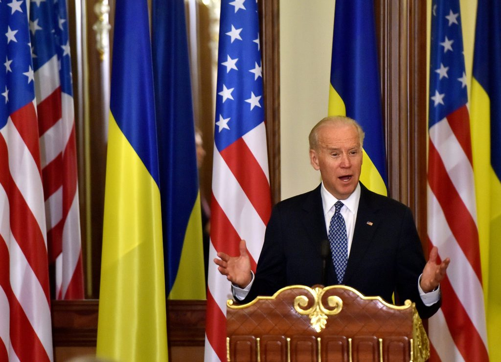 U.S. Vice President Joe Biden gestures as he delivers a statement on the results of talks with the Ukrainian president in Kiev on Dec/ 7, 2015. Biden, on a three-day working visit to Ukraine, said the world's focus on Syria did not overshadow Western demands for Russia to adhere to a shaky Ukrainian peace agreement and to hand back Crimea to Kiev. SERGEY SUPINSKI/AFP/Getty Images