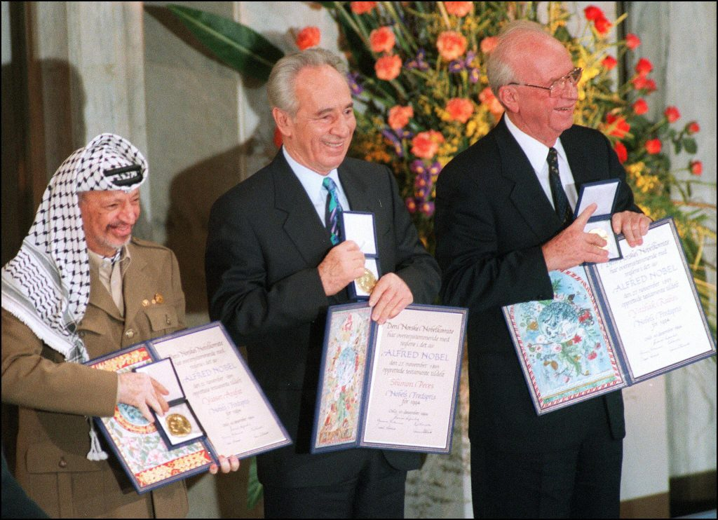 Yasser Arafat, chairman of Palestine Liberation Organisation, Shimon Peres and Israeli Prime Minister Yitzhak Rabin pose with their Nobel Peace prize, in Oslo on Dec. 10, 1994. MENAHEM KAHANA/AFP/Getty Images