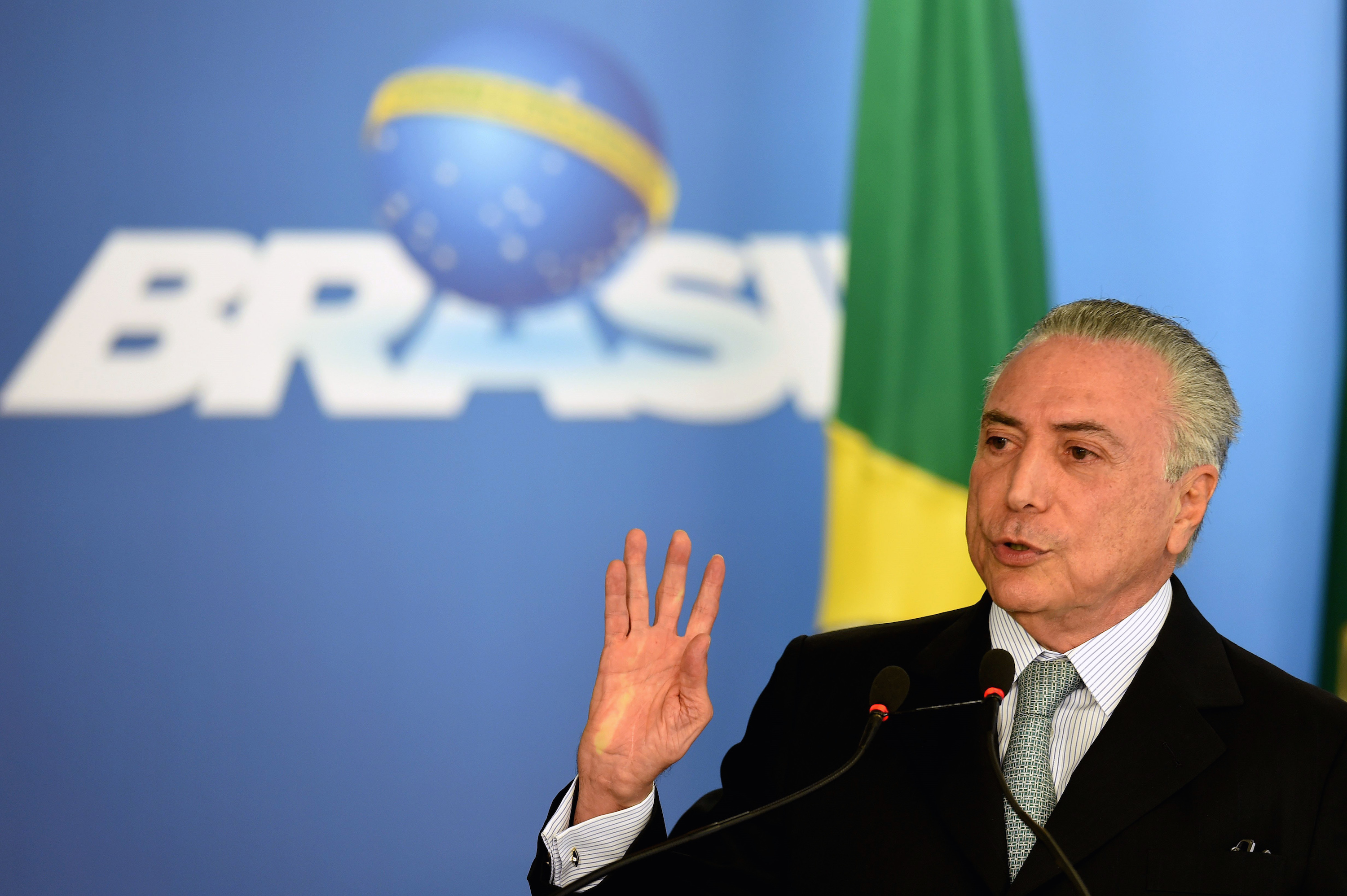 Brazilian acting President Michel Temer delivers a speech during the inauguration ceremony of the new Minister of Transparency, Torquato Jardim, at Planalto Palace in Brasilia, on June 2, 2016. Brazil's interim government on Monday suffered its second crisis in a week when the Minister of Transparency Fabiano Silvera resigned after he criticised the investigation of corruption in state oil company Petrobras. Temer has picked a market-friendly economic team and vowed to make extensive reforms, but already has lost two of his new ministers to a massive corruption scandal centered on state oil company Petrobras. / AFP / EVARISTO SA (Photo credit should read EVARISTO SA/AFP/Getty Images)