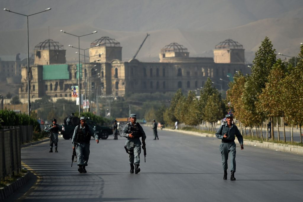 Afghan security personnel walk near the site of an attack on the elite American University of Afghanistan, in Kabul on Aug. 25. WAKIL KOHSAR/AFP/Getty Images