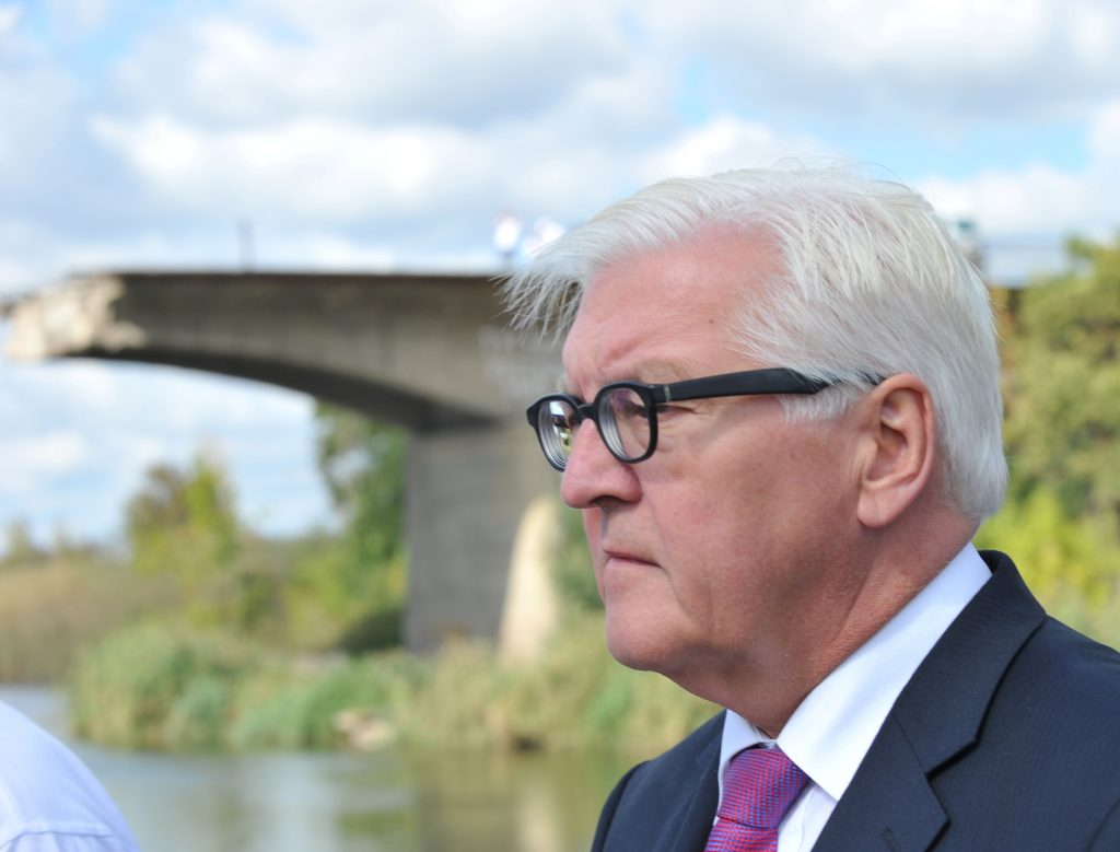 German Foreign Minister Frank-Walter Steinmeier stands in front of a destroyed bridge during a visit with his French counterpart in Slavyansk, Donetsk region, Ukraine on Sept. 15, 2016. The German and French foreign ministers made their first visit to Ukraine's war-torn east since the beginning of the conflict between government forces and pro-Russian rebels in April 2014. SERGEY BOBOK/AFP/Getty Images