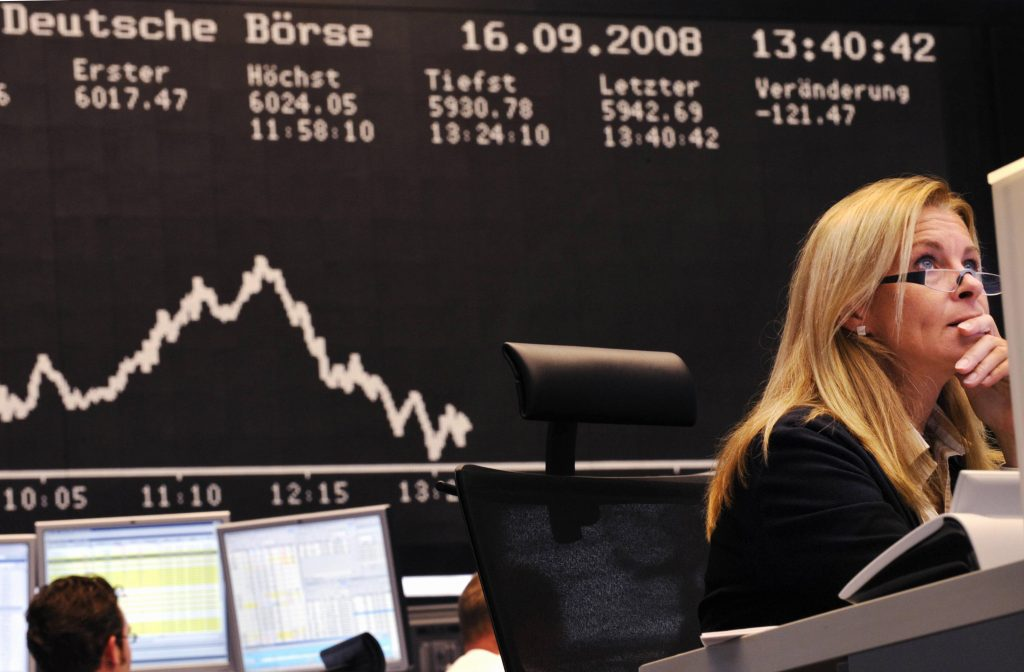 Stock brokers look at their screens at Frankfurt's stock exchange on Sept. 16, 2008, as the blue chip DAX 30 was down over three percent at 1300 GMT, adding to a 2.74 percent fall the day before after US investment bank Lehman Brothers filed for bankruptcy protection. THOMAS LOHNES/AFP/Getty Images